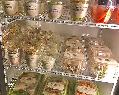 Micromarket fridge with fresh, healthy food.